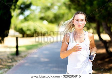 Runner Woman Jogging In Summer Fitness Workout. Running, Sport, Healthy Active Lifestyle Concept