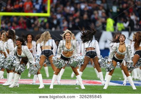 LONDON, ENGLAND - OCTOBER 06 2019: Oakland Raiders cheerleaders perform during the NFL game between Chicago Bears and Oakland Raiders at Tottenham Stadium in London, United Kingdom.