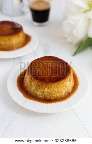 Caramel Flan, Crema Catalana Dessert On White Woden Table