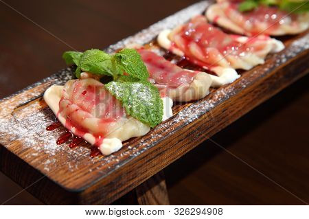 Dumplings With Potato In Sour Cream On A Wooden Board.  Dumplings With Mushrooms. Dumplings With Che
