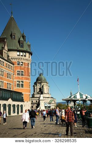 QUEBEC-CANADA, SEPT 12, 2019:  People walking on Terrasse Dufferin close the Chateau Frontenac, an historic hotel in Quebec City, Quebec, Canada, one of the most photographed in the world.