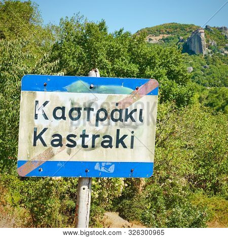 Road sign on the way out of Kastraki village at the foot of Meteora rocks, Greece