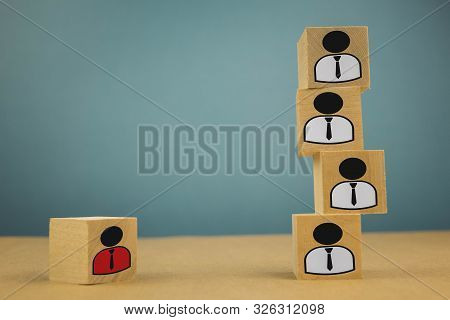 Wooden Cubes In The Form Of Bosses And Subordinates, Personnel Subordination On A Blue Background