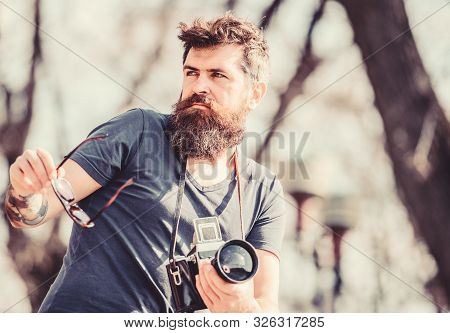 Photographic Equipment. Hipster Man In Sunglasses. Mature Hipster With Beard. Bearded Man. Brutal Ph
