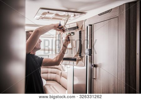 Broken Rv Air Condition Unit Repair By Professional Technician. Travel Trailer Appliances. Travel In