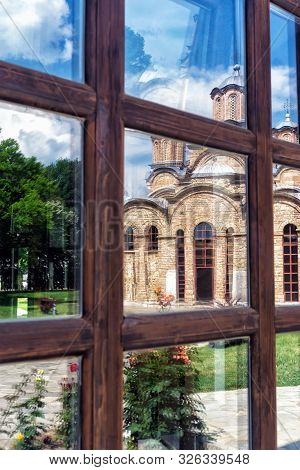 Reflection in the window of the Gracanica Serbian Orthodox Monastery in Kosovo poster