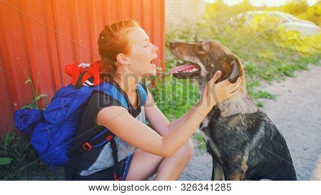 Portrait Young Hipster Woman With Backpack Kissing Dog Outdoors Happy Pet And Attractive Girl Playin