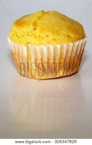 Cornbread. Hot fresh home made Corn Bread Muffins. Isolated on white. Room for text.
