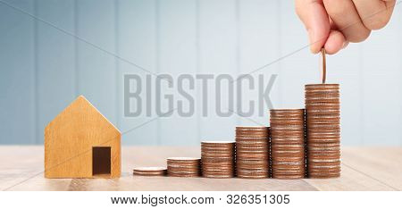 Wooden Toy House Mortgage Property Home Concept Buying For Family, Coins In Hand