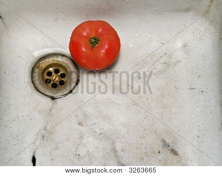 rusty old sink and a red tomato poster