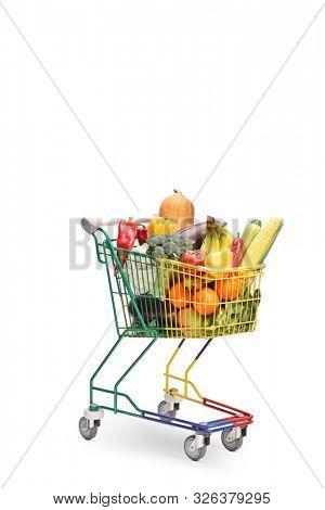Colorful mini pushcart with many fruits and veggies isolated on white background