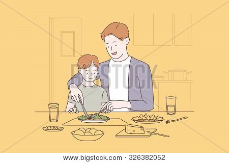Family Bonding, Happy Parenting Concept. Father Teaching Son To Use Fork And Knife, Cheerful Dad Sho