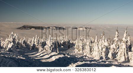 Ondrejnik Mountain Ridge Above Clouds Level Feom Hiking Trail Bellow Lysa Hora Hill In Moravskoslezs