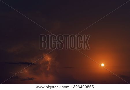 Picturesque Bright Orange Colours Cloudy Sky With Full Moon And Lighting During Mucky Weather, Full