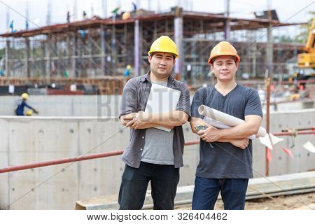 Construction Concept Of Engineer And Architect Working At Construction Site With Blue Print