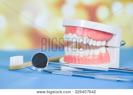 Dentist Tools With Bamboo Toothbrush Dentures Dentistry Instruments And Dental Hygienist Checkup Con