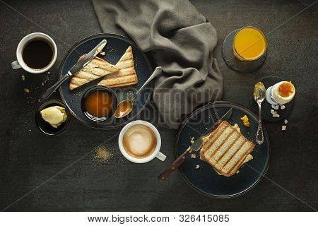 Breakfast Served With Coffee, Juice, Toast Sendwich, Boiled Egg, And Jam With Butter. Delicious Heal
