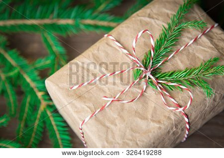 Christmas Gifts Box Presents On Brown Wooden Background. Wrapping Christmas Present In Craft Paper