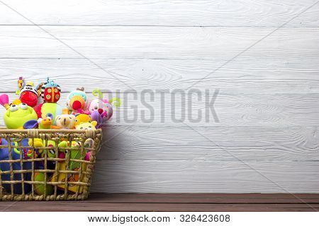 Toys Collection In Box On Abstract Wooden Background. Donatation. Copy Space For Text