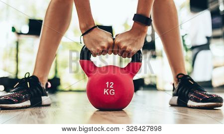 Cropped Close-up Image Of Young Fitness Woman Doing Swing Exercise With A Kettlebell As A Part Of A