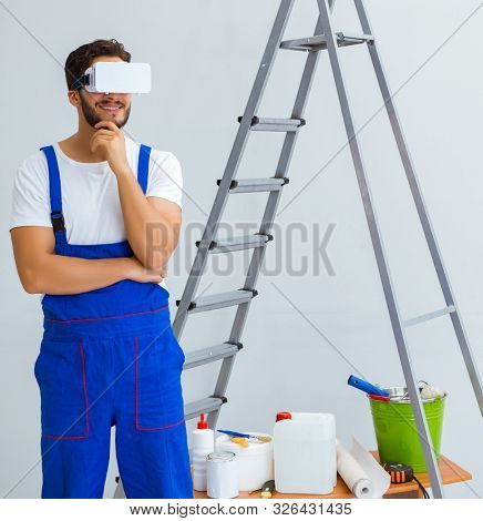 Man with VR glasses gluing wallpaper poster