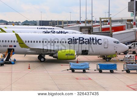 Amsterdam, Netherlands - July 11, 2017: Air Baltic Boeing 737 At Schiphol Airport In Amsterdam. Schi