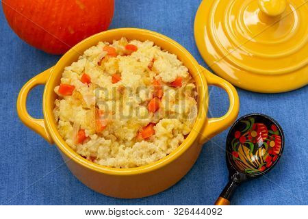 There Is A Delicious Yellow Freshly Cooked Millet Porridge With Pumpkin And Onions For Breakfast. On
