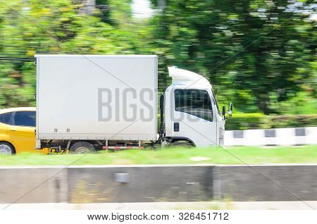 Motion Photos, Small White Truck For Logistics On The Road.