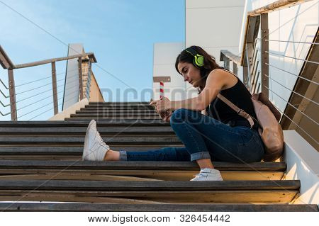 Stock Photo Of A Portrait Of A Young Woman In A Park Of A City. Lifestyle, Posing