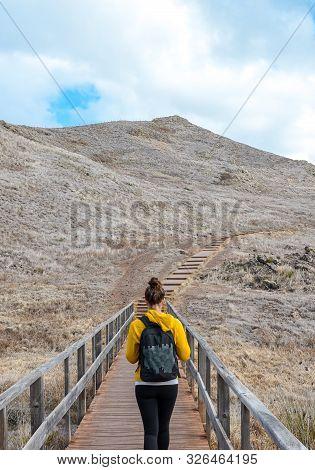 Young Woman In Yellow Sweater On Hiking Trail On Ponta De Sao Lourenco In Madeira, Portugal. Peninsu