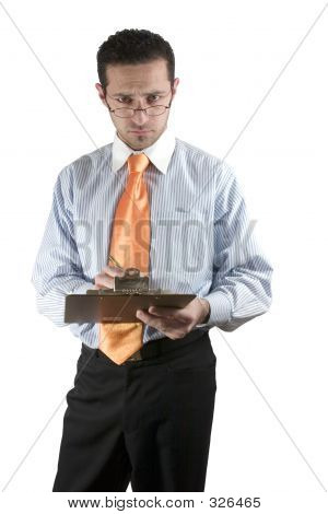 Businessman Looking Over His Glasses With Clipboard On Hand