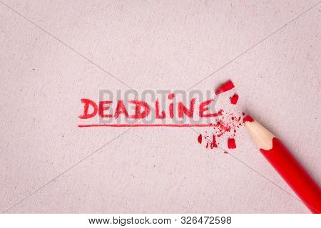 Deadline. The Word Deadline Written On Paper. Concept. Deadlines For Completing A Plan Or Assignment