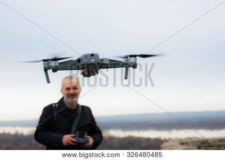 Elabuga, Russia, October 6, 2019: A Smiling Man Launches A Copter. The Copter Is In The Foreground,