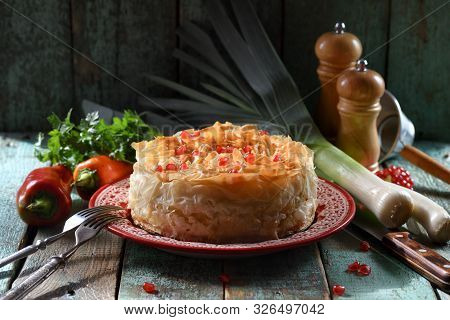 Savory Pastry With Phyllo Dough. Homemade Pie On Red Plate On Blue Wooden Background Copy Space. Low