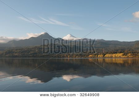 Reflection Of The Volcano Villarica On The Coñaripe City Lake