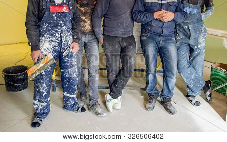 Workers And Builders And Foreman Are As Gang With Dirty Uniform Are Staying In Apartment That Is Und