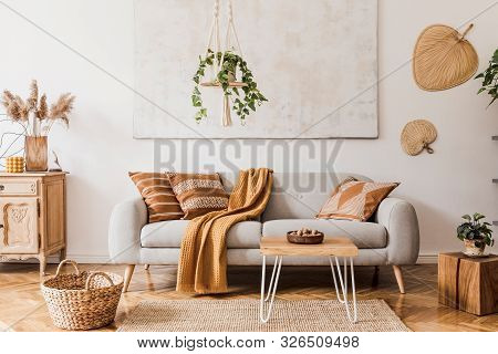 The Stylish Boho Compostion At Living Room Interior With Design Gray Sofa, Wooden Coffee Table, Comm