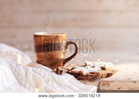 Christmas Still Life. Mug Of Hot Steamy Tea, Gingerbread Cookies At Wooden Background With Glares. C