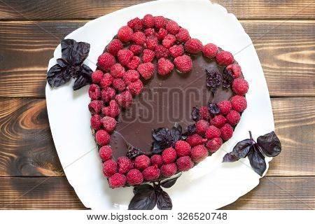 Cheesecake For Vegans With Love. Topped With Raspberries, On White Plate With Basil Leaves. Made In