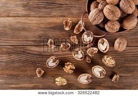 Walnuts. Whole Walnut, Peeled Walnut, Half Walnut, Walnut Shell, Walnut Kernel Pour From Decorative