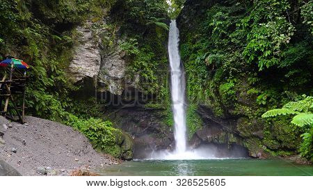 Beautiful Waterfall In Green Forest. Tropical Tuasan Falls In Mountain Jungle. Waterfall In The Trop
