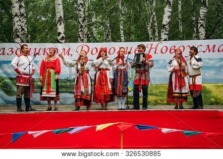 Voronezh, Russia - Circa, 2012: Traditional Russian Folklore Ensemble At The Fair, Accordionist And
