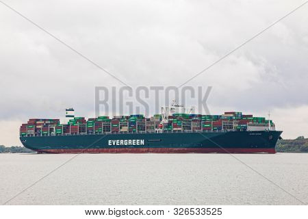 Stade, GErmany - September 25, 2019: Container ship EVER GIVEN, owned by Evergreen Marine Corp. (Taiwan) Ltd., on Elbe river heading to Hamburg