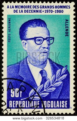 Moscow, Russia - October 07, 2019: A Stamp Printed In Togo Shows Salvador Allende (1908-1973), Chile