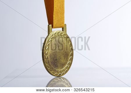 blank gold medal on the white background