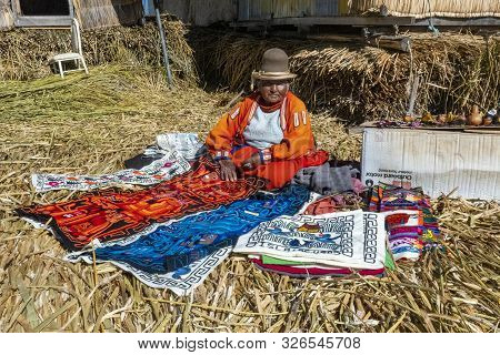 Lake Titicaca, Peru - August 2, 2019: Uros Tribe Demonstrating Life On The Floating Island At Lake T