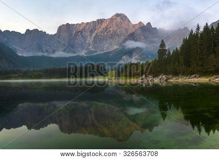 Panorama Of The Beautiful Mountain Laghi Di Fusine Lake In Italy During Sunrise