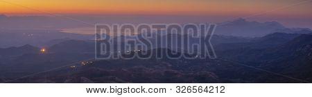 Panorama Of Skadar Lake In Montenegro During Sunrise On A Beautiful Foggy Morning. Visible Mountains