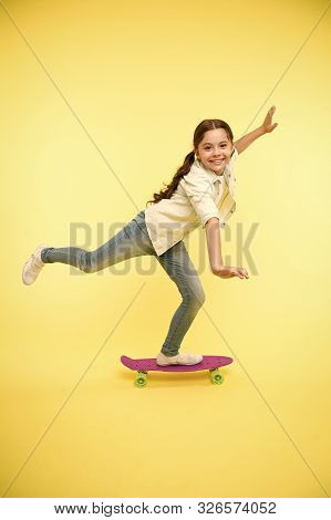 Kid Having Fun With Penny Board. Hobby Favorite Activity. Child Smiling Face Stand On Skateboard. Pe