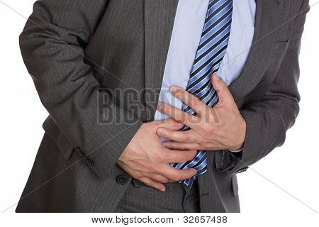 Businessman holding his stomach in pain or indigestion